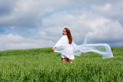 Young woman in a field. Stock Photography