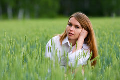 Young woman in a field. Royalty Free Stock Image