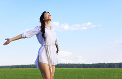 Young woman in field Stock Photography