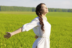 Young woman in field Stock Photos