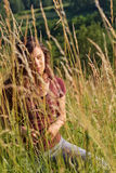 Young woman in a field Stock Images