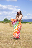 Young woman on a field. Royalty Free Stock Images