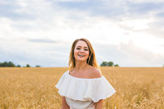 Young woman on a field royalty free stock photos
