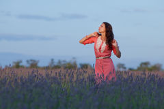 Young woman in the field of blossoming lavender royalty free stock photo