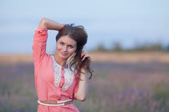 Young woman in the field of blossoming lavender Stock Images