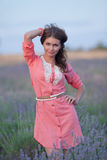 Young woman in the field of blossoming lavender Royalty Free Stock Photography