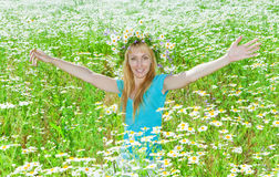 The young woman in the field of camomiles Stock Photography