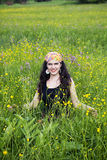 Young woman in a field of flowers Royalty Free Stock Image