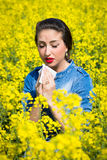 Young woman in a field has hay fever Royalty Free Stock Photography