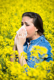 Young woman in a field has hay fever Stock Images