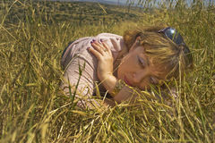 A Young Woman in the Field. A young woman in a spring wheat field Royalty Free Stock Images