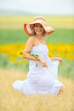 Young woman on field in summer Royalty Free Stock Image