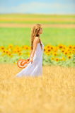 Young woman on field in summer Stock Photo