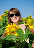Young woman on a field in summer stock photos