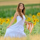 Young woman on field in summer Stock Photos