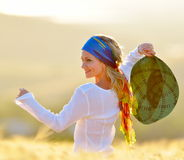 Young woman on field in summer Royalty Free Stock Photography