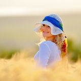 Young woman on field in summer Royalty Free Stock Images