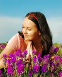 Young woman in the field of violet f Stock Image