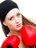 Young woman fighter with boxing gloves over white Royalty Free Stock Image