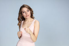 Young woman in fighting stance Royalty Free Stock Photos