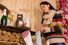 Young woman filling Christmas stockings Stock Images