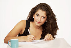 Young woman filling document Stock Image