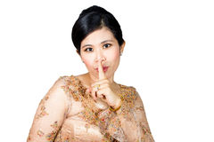 Young woman with finger in front of her lips. Royalty Free Stock Photos