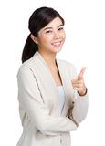 Young woman with finger gesture point to front Stock Photo