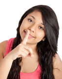 Young woman with finger on her lips Royalty Free Stock Image
