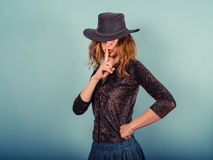 Young woman with finger on her lips Stock Images