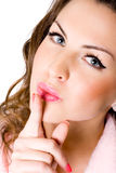 Young woman with finger on lips Royalty Free Stock Images