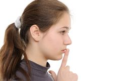 Young woman with finger on lips Stock Photos