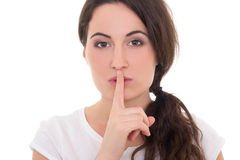 Young woman with finger on lips isolated on white Royalty Free Stock Photo