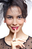 Young woman  with finger on lips Royalty Free Stock Photography