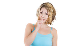 Young woman with finger in mouth sucking thumb or biting fingernail in anxiety,stress, or bored Stock Images