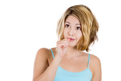 Young woman with finger in mouth sucking thumb or biting fingernail in anxiety,stress, or bored and clueless Stock Image