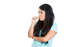 Young woman with finger in mouth sucking thumb or biting fingernail in anxiety,stress, or bored and clueless about situation Royalty Free Stock Photos