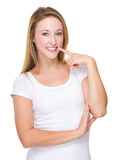 Young Woman finger point to her teeth Stock Photos