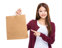 Young woman finger point to shopping bag Royalty Free Stock Images
