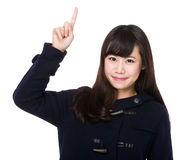 Young woman with finger point up Royalty Free Stock Image