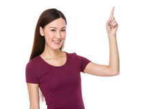 Young woman with finger point up Royalty Free Stock Photography