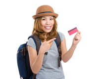 Young woman finger pointing to credit card for journey Royalty Free Stock Photo