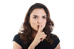 Young woman with finger to lips Royalty Free Stock Photography