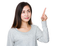Young Woman with finger touch on the imaginary panel Royalty Free Stock Image