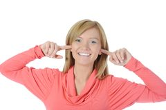 Young woman with fingers in ears Stock Photos