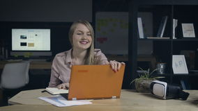 Young woman finishes work in office stock video