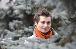 Young woman with fir tree Stock Photos