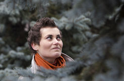 Young woman in fir tree Royalty Free Stock Photography