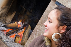 Young woman by the fire Stock Photo
