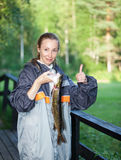 The young woman the fisherman with the caught pike Stock Photo